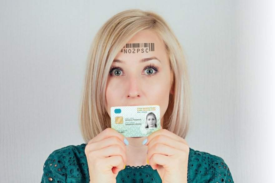 Woman holding PSC card